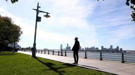 Newsday's food critic Scott Vogel walks along the