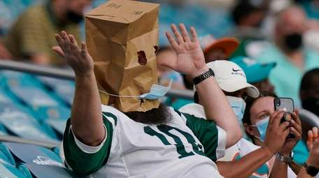 A New York Jets fans reacts to the