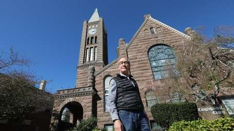 The Rev. Dwight Lee Wolter in front of