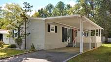 This two-bedroom, two-bath mobile home in the Riverwoods