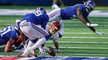 Washington Football Team quarterback Kyle Allen (8) loses