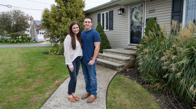 Nicole and Cory Fraile, outside their West Babylon