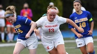 Kellenberg's Caitriona Smith defends against Sacred Heart's Beth