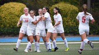 Sacred Heart's Grace Byrne (15) and teammates celebrate