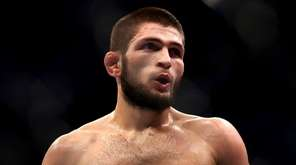 Khabib Nurmagomedov against Dustin Poirier in their lightweight