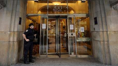 An NYPD officer stands outside the Board of