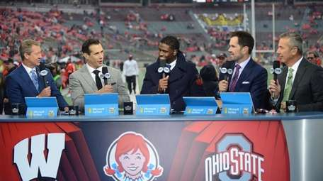 Urban Meyer, far right, on the set of