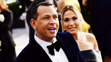 Alex Rodriguez and Jennifer Lopez attend the 26th