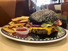A bacon cheeseburger at Bethpage Burger Bar, served