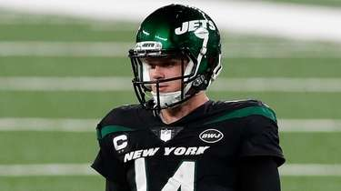 Sam Darnold of the Jets looks on during