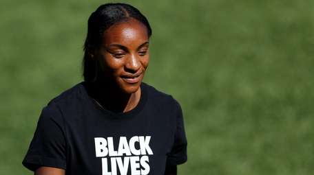 Crystal Dunn looks on before the quarterfinal match