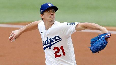 Dodgers starting pitcher Walker Buehler throws against Atlanta