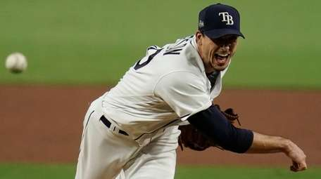 Rays starting pitcher Charlie Morton throws against the