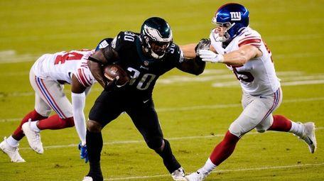 Philadelphia Eagles' Corey Clement (30) tries to get