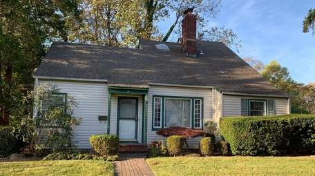 This four-bedroom Cape in Amityville is listed for