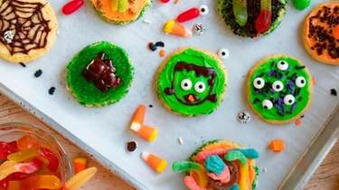 Slice-and-bake cookies topped with frosting and candy for