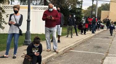 People wait in line to vote in Freeport