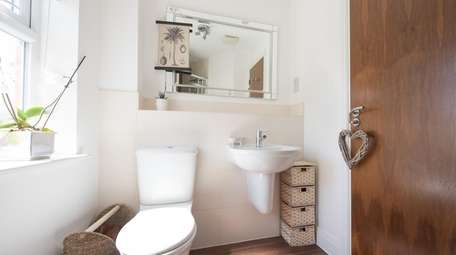 Go big on bathroom design without breaking the