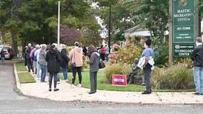 Long lines greeted Mastic voters as they headed