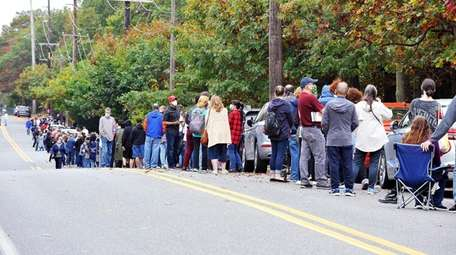 In Nesconset, crowds wait along Browns Road to