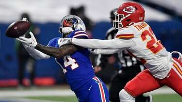 Kansas City's Juan Thornhill, right, breaks up a