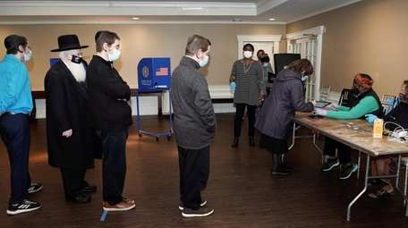 People line up to vote on the second
