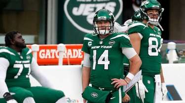 Sam Darnold #14 of the Jets walks on
