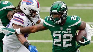 La'Mical Perine of the Jets runs the ball