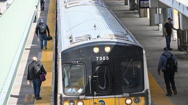 Commuters prepare to board a train toward Penn