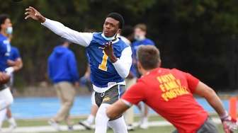 Kellenberg quarterback Ethan-Kiyh Greenwood passes against Chaminade during