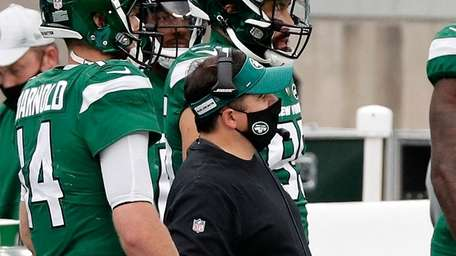 Offensive coordinator Dowell Loggains of the Jets stands