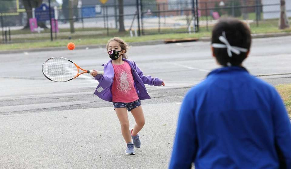Sienna Gonzales, 7, of Manhasset, practices her tennis