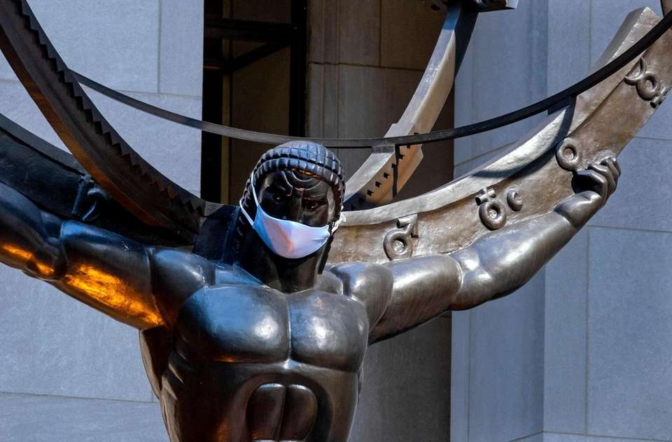 The Atlas Statue At Rockefeller Center presents a