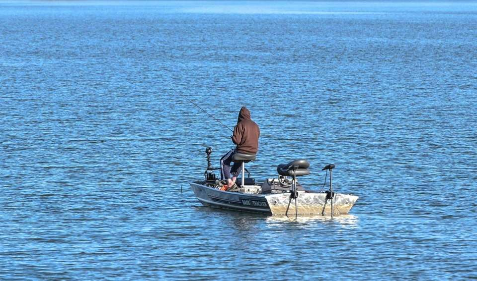 A man fishes in Lake Ronkonkoma on Saturday,