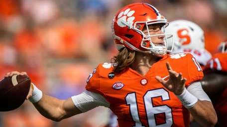 Clemson quarterback Trevor Lawrence (16) makes a pass