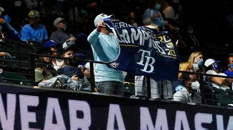 Rays fans hold up a banner during the