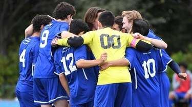 Kellenberg players huddle before a CHSAA boys soccer