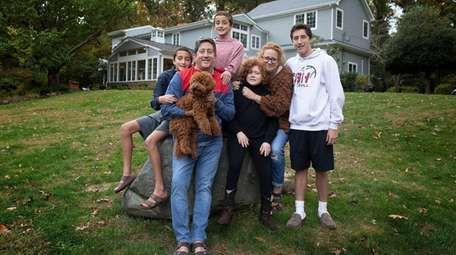 Bruce and Nicole Gerberg with four of their