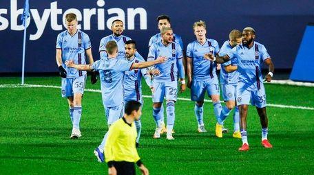 New York City FC players celebrate a goal