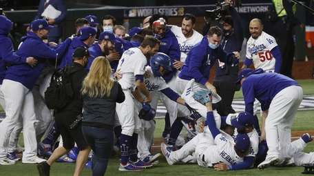 Dodgers players celebrate after defeating the Rays to