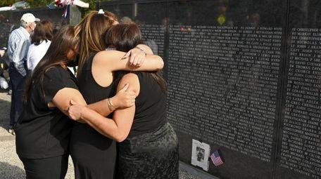 Lea Schulman, far right, of Brooklyn, is comforted