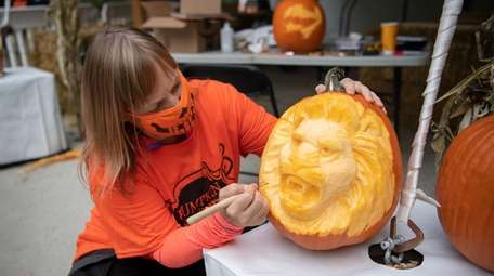 """Sue Beatrice shows a pumpkin-carving technique at """"Boo"""