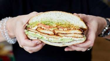 The cemita sandwich with chicken cutlet, lettuce, tomato,