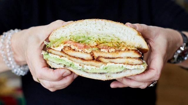 The cemita sandwich with chicken cutlet, lettuce, tomato,