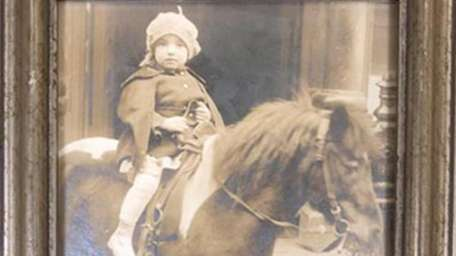 Goldie Schreiber sits atop a pony as a