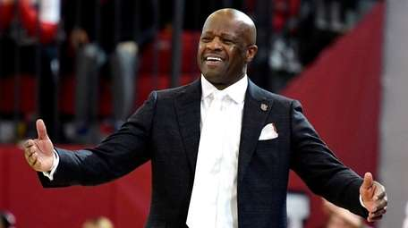 St. John's head coach Mike Anderson reacts against
