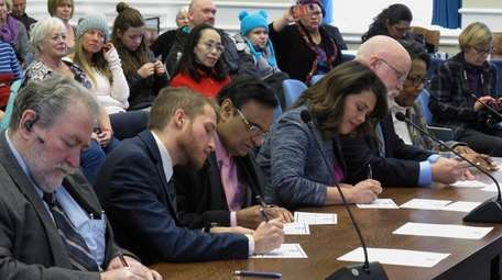Nevada's six Democratic presidential electors sign their formal