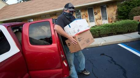 Curt Polly of Setauket brings donations to The