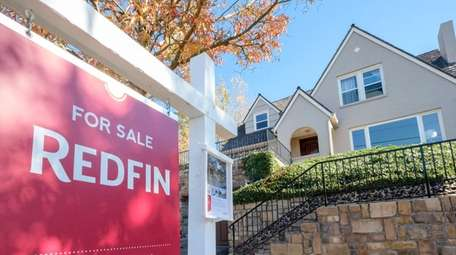 A Redfin yard sign announces a home for