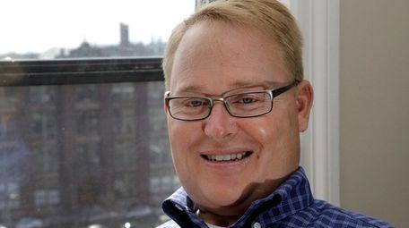 Former Boston University hockey player Travis Roy poses